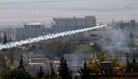 A rocket believed to have been launched by Islamic State forces flies from the east to the west side of the Syrian town of Kobani during fighting on November 6, 2014
