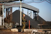 A pro-Russian separatist stands guard at coal mine number 22 'Kommunar' in the village of Nizhnyaya Krynka, east from Donetsk, November 6, 2014.