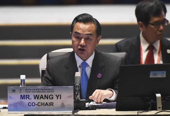 China's Foreign Minister Wang Yi speaks at the start of Asia-Pacific Economic Cooperation (APEC) Summit ministerial meetings at the China National Convention Centre (CNCC) in Beijing, November 7, 2014.