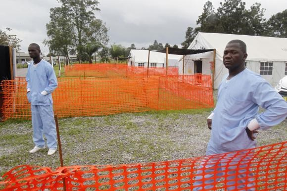 Health workers stand at an Ebola treatment unit at the main hospital of Yopougon in Abidjan October 25, 2014.