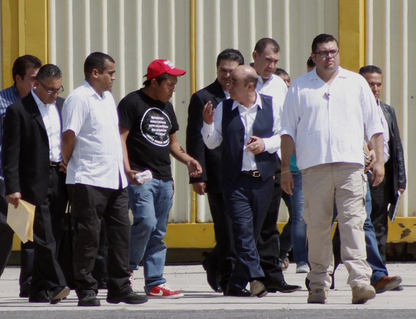 Relatives of 43 missing students leave at the end of a private meeting with Mexican Attorney General Jesus Murillo Karam (3rd-R) in Chilpancingo, Mexico on November 7, 2014