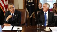 U.S. President Barack Obama (L) speaks as Secretary of Defense Chuck Hagel listens before the start of a Cabinet Meeting in the Cabinet Room at the White House in Washington, November 7, 2014.