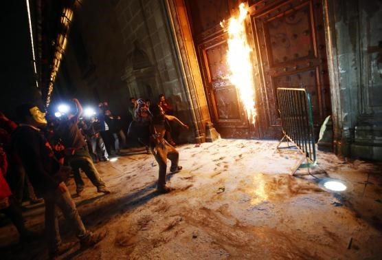 A group of protesters set fire to the wooden door of Mexican President Enrique Pena Nieto's ceremonial palace during a protest denouncing the apparent massacre of 43 trainee teachers, in the historic center of Mexico City late November 8, 2014.