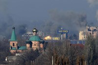 Smoke rises above an old terminal (L) and an administrative building of the Sergey Prokofiev International Airport after the recent shelling during fighting between pro-Russian separatists and Ukrainian government forces in Donetsk, eastern Ukraine, Novem