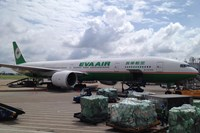 An EVA Airways Corp. Boeing 777 passenger plane stands on the tarmac at Tan Son Nhat International Airport in Ho Chi Minh City, Vietnam, on Nov. 5, 2014. EVA Airways, like other airlines, carries cargo in the bellies of passenger planes. The company plans