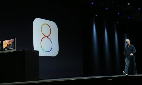 Apple CEO Tim Cook introduces the IOS 8 operating system during his keynote address at the Worldwide Developers Conference in San Francisco, California June 2, 2014.