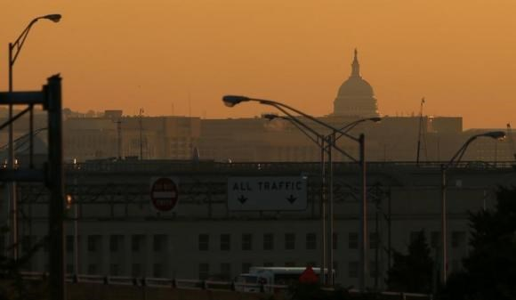 The dome of the U.S. Capitol rises over the Pentagon and other federal buildings in Washington during sunrise, October 2, 2013.