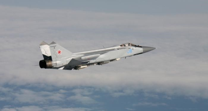 An undated handout photo provided by the Norwegian Army shows a Russian Mikoyan MiG-31 aircraft over an unknown location during a military exercise.