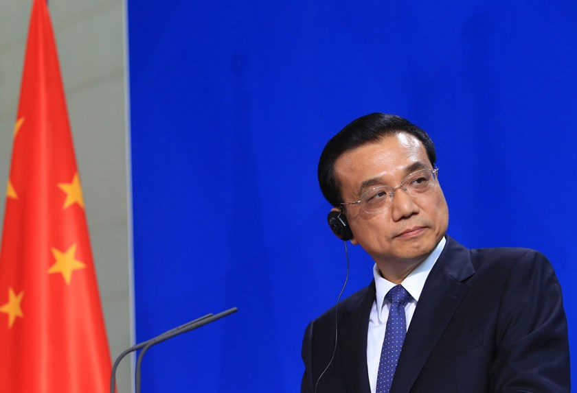 For Premier Li Keqiang, the question is whether to stick with targeted liquidity injections or embrace nationwide monetary or fiscal easing that reignites the risk of a jump in debt.