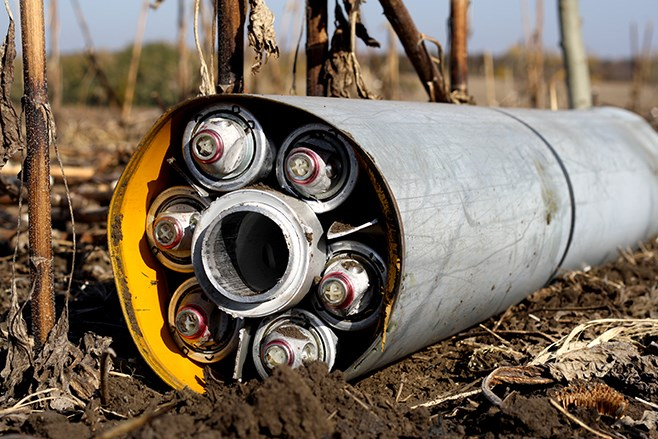 Remnants of a misfired Uragan cluster munition rocket lying in a field in territory controlled by the Ukrainian government near Novomykhailivka, Ukraine on October 14, 2014.