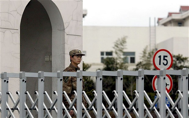 A military guard outside headquarters of the secretive PLA Unit 61398 on the outskirts of Shanghai.