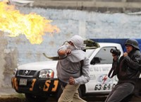Molotov cocktails, clashes as thousands of Mexicans protest massacre