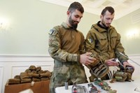 Medical volunteers unpack individual first aid kits similar to those used by NATO during a ceremony where they were donated by Kiev's Mayor Vitaly Klitschko in Kiev October 31, 2014.
