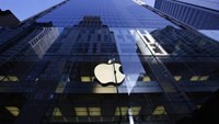 The Apple logo is lit on the first day of sale for the iPhone 6 and iPhone 6 Plus, in Sydney September 19, 2014.