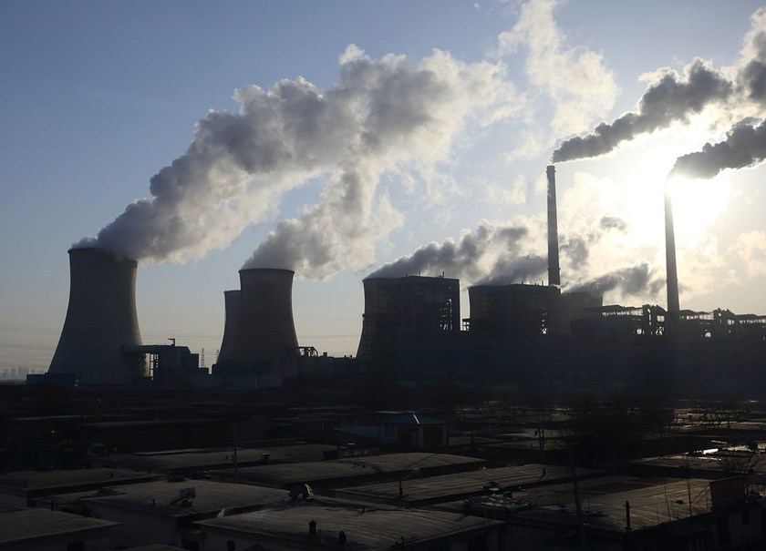 Steam rises from cooling towers at the Junliangcheng power station in Tianjin, China. In his agreement last week with President Barack Obama, Chinese President Xi Jinping committed to cap carbon emissions by 2030 and turn to renewable sources for 20 perce