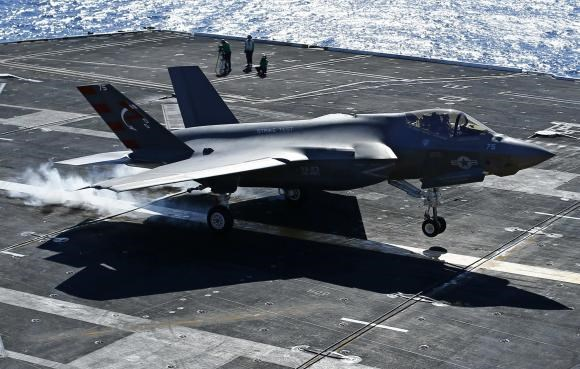 U.S. Navy test pilot Ted Dyckman makes a successful landing of a Lockheed Martin Corp's F-35C Joint Strike Fighter on an aircraft carrier using its tailhook system, while off the coast of California, November 3, 2014.