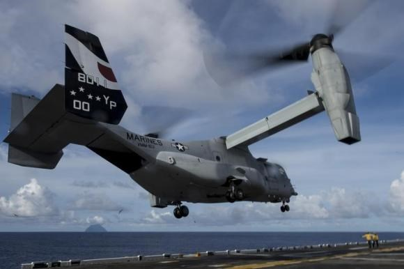 An MV-22 Osprey attached to Marine Medium Tiltrotor Squadron (VMM) 163 launches from the flight deck of amphibious assault ship USS Makin Island in this handout photo provided by the U.S. Navy and taken August 16, 2014.