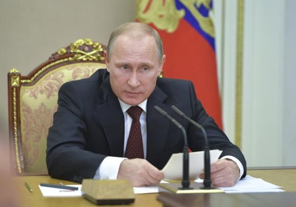 Russian President Vladimir Putin chairs a meeting of the Security Council at the Kremlin in Moscow, November 20, 2014.