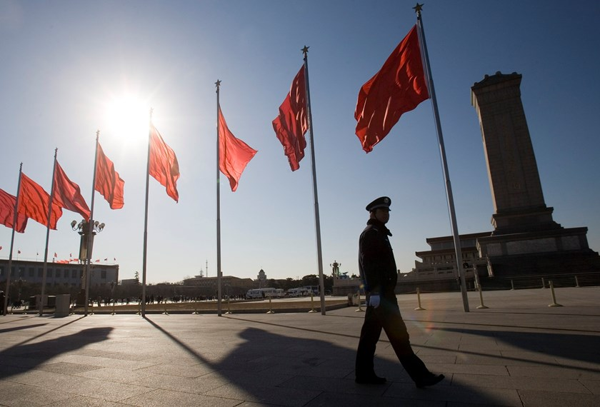 A police officer patrols Tiananmen Square in Beijing, China.