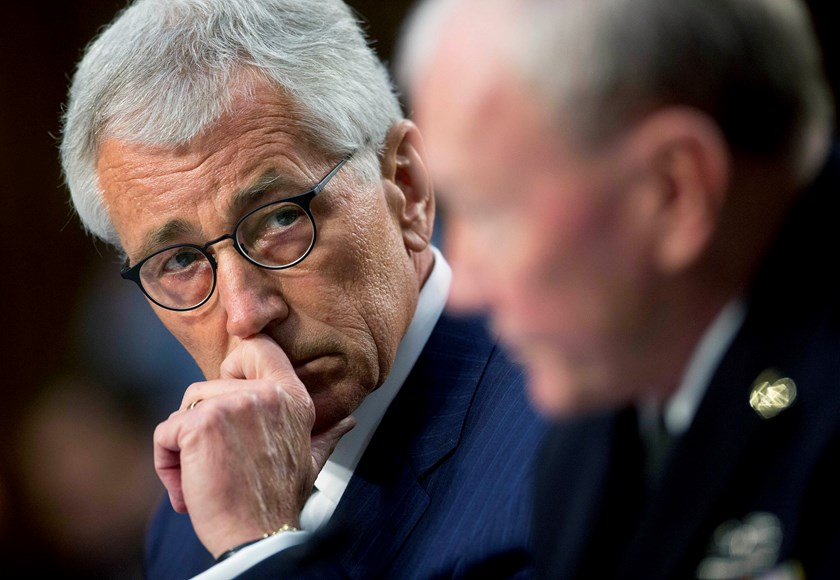 Chuck Hagel, U.S. secretary of defense, left, looks on as General Martin Dempsey, chairman of the Joint Chiefs of Staff, speaks during a Senate Armed Services Committee hearing in Washington, D.C., on Sept. 16, 2014.
