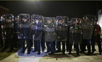 Missouri State Troopers in riot gear stand in formation outside the Ferguson Police Department in Ferguson, Missouri, November 24, 2014.