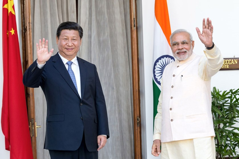 Narendra Modi, India's prime minister, right, and Xi Jinping, China's president, arrive for delegation talks at Hyderabad House in New Delhi, India, on Sept. 18, 2014.