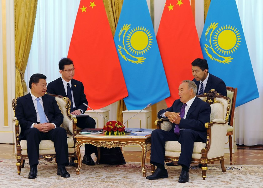 China's President Xi Jinping, left, speaks with Kazakhstan's President Nursultan Nazarbayev, right, during a meeting in Astana, on Sept. 7, 2013.