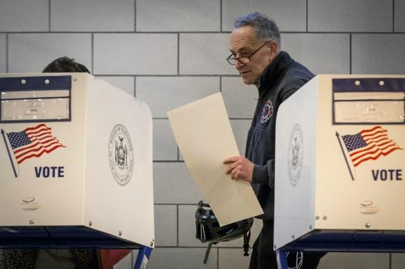 Senator Charles Schumer casts his vote at a polling station in Brooklyn.