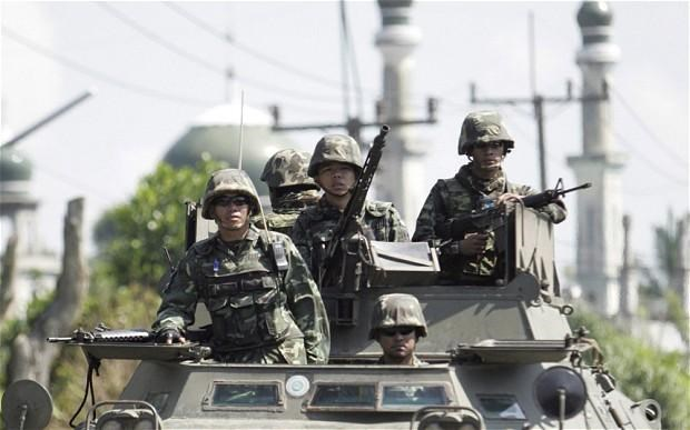 Thai soldiers on patrol in southern Thailand's Pattani province