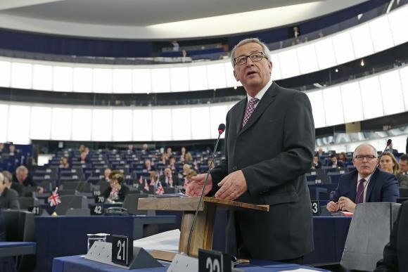 European Commission President, Luxembourg's Jean-Claude Juncker addresses the European Parliament to present a plan on growth, jobs and investment, in Strasbourg, November 26, 2014.