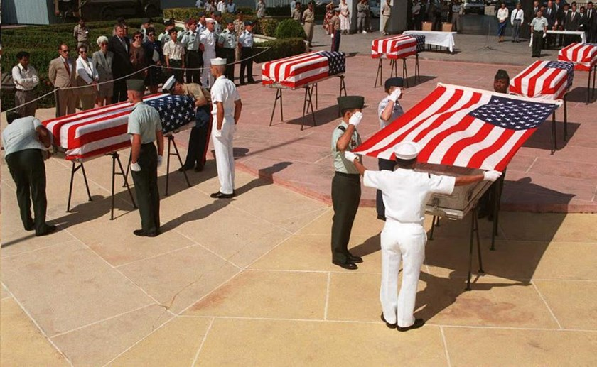 Photo taken in December 1995 shows US servicemen draping the American flag over coffins containing the possible remains of US servicemen that are missing in action the Vietnam War
