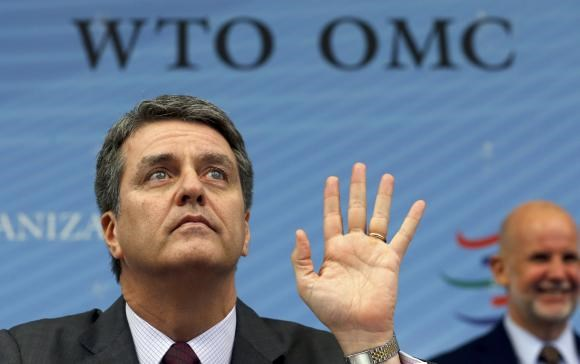 World Trade Organization (WTO) Director-General Roberto Azevedo (R) gestures before a special meeting of the General Council Preparatory Committee on Trade Facilitation at the WTO headquarters in Geneva November 27, 2014.