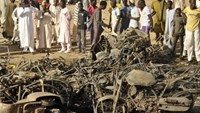 A crowd gathers at a scene of multiple bombings at Kano Central Mosque November 28, 2014.