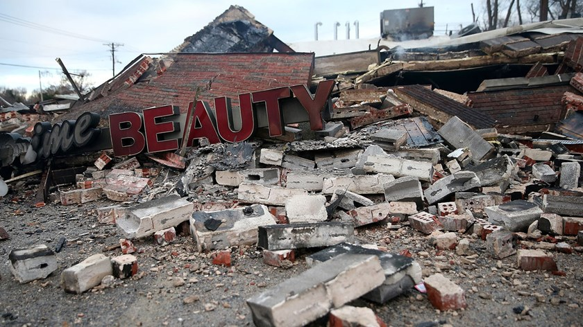A sign sits amidst rubble from a building that was damaged during a demonstration in Dellwood, Missouri, on Nov. 25, 2014.