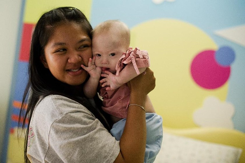 Thai surrogate mother Pattaramon Chanbua (L) was at the centre of a surrogacy scandal when Australian parents rejected the Downs Syndrom baby she was carrying for them