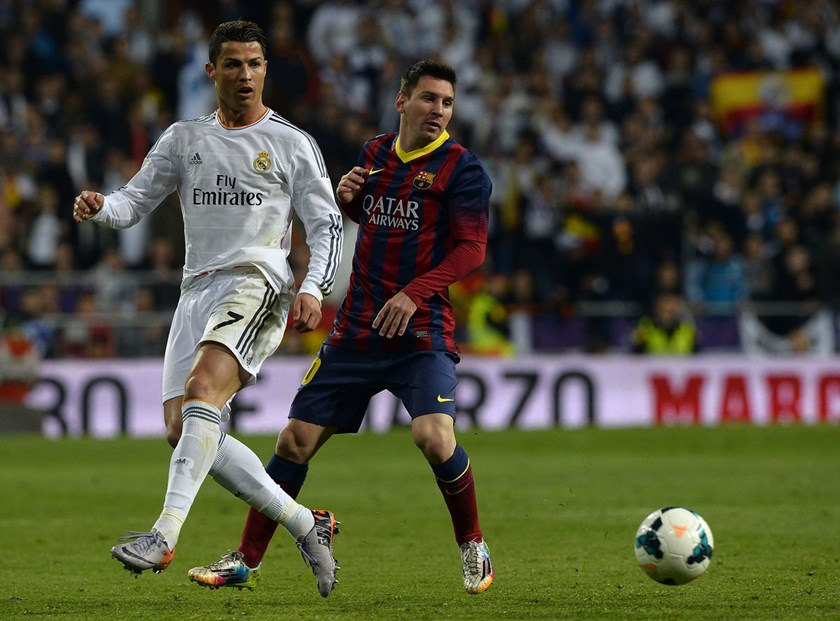 Real Madrid's Cristiano Ronaldo, left, and Barcelona's Lionel Messi, right, during the football match Real Madrid CF vs FC Barcelona at the Santiago Bernabeu stadium in Madrid.