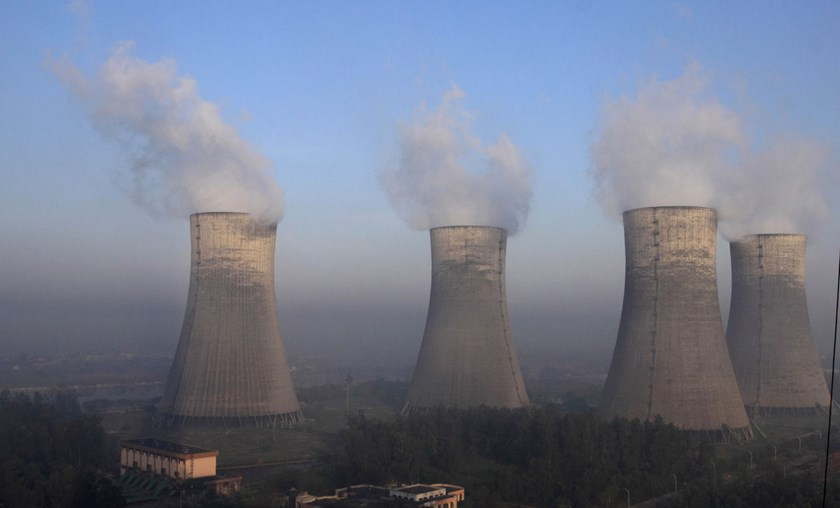 Cooling towers stand at the NTPC Ltd. power station in Dadri, India. Carbon dioxide emissions will jump 34 percent in India by 2020 and double by 2030 under its existing policies, according to the International Energy Agency.