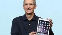 Apple CEO Tim Cook holds the new iPad Air 2 during a special event on Oct. 16, 2014 in Cupertino, California.