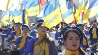 Ukrainians carry national flags as they take part in a march to call for an end to the war in Ukraine and demand peace throughout the country on Oct. 04, 2014 in Kiev, Ukraine.