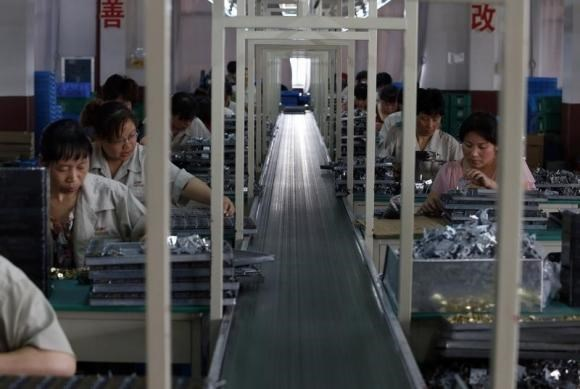 Employees work at a timing device factory in Jinhua, Zhejiang province May 24, 2013.