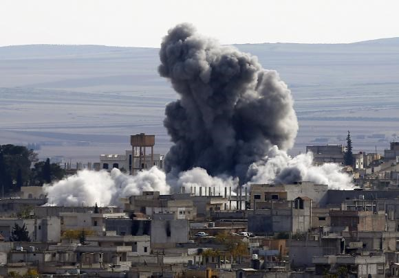 An explosion following an air strike is seen in western Kobani neighbourhood, November 23, 2014.