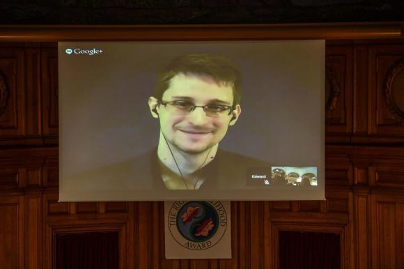 Former U.S. NSA contractor Edward Snowden, is shown on a livestream from Moscow, during the Right Livelihood Award ceremony at the second chamber hall at the Swedish Parliament in Stockholm December 1, 2014.