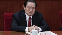 China's former Politburo Standing Committee Member Zhou Yongkang attends the closing ceremony of the National People's Congress (NPC) at the Great Hall of the People in Beijing March 14, 2012.