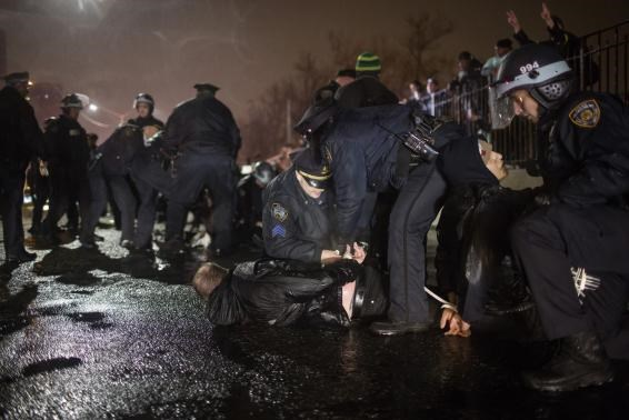 A protester is taken into custody along FDR Drive in Manhattan in New York City as thousands of demonstrators took to the streets of New York demanding justice for the death of Eric Garner December 5, 2014.