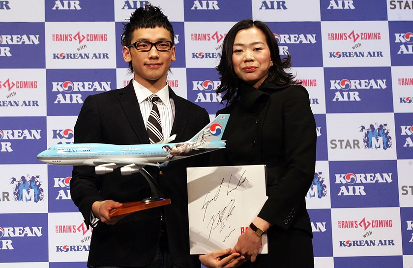 South Korean pop singer Rain, left, with Heather Cho, managing Vice President of Korean Air in Incheon, South Korea.