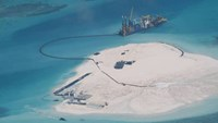 A February 2014 photo taken by surveillance planes for the Philippines government shows Chinese construction work on Johnson Reef in the disputed Spratly Islands. Photo: Philippines Department of Foreign Affairs