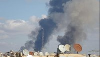 Smoke rises after what activists said were airstrikes by forces loyal to Syria's President Bashar al-Assad in Raqqa, eastern Syria, which is controlled by the Islamic State November 25, 2014.