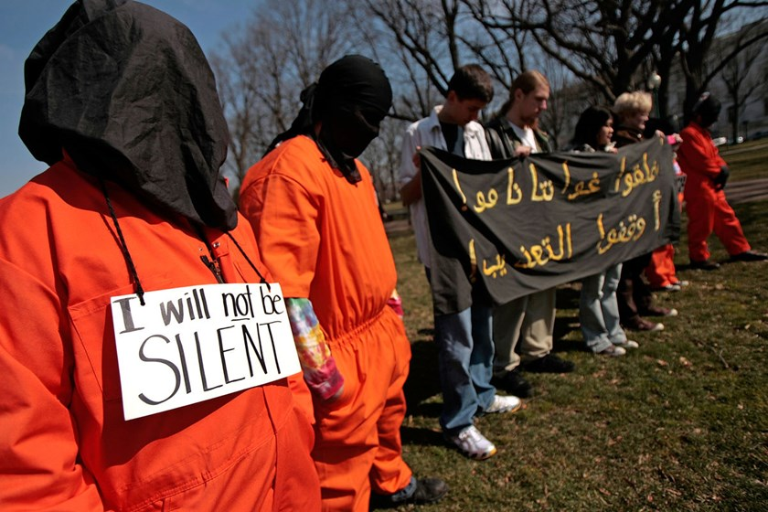 Members and supporters of The Washington Region Religious Campaign Against Torture dress as detainees during a rally on Capitol Hill in Washington, DC, on Mar. 10, 2008.