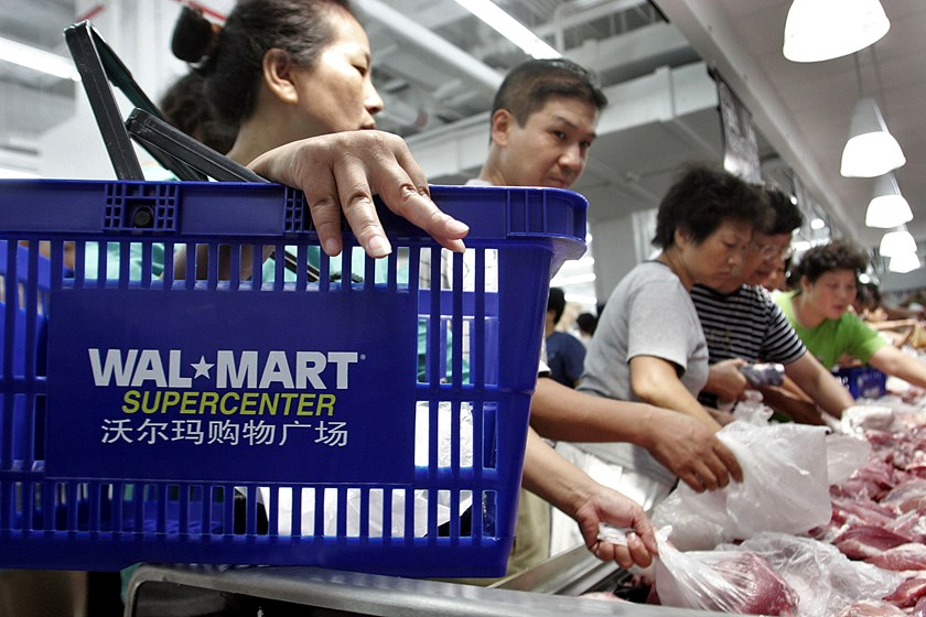 Chinese customers choose frozen meat at a Wal-Mart store in Shanghai.