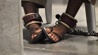"A Guantanamo detainee's feet are shackled to the floor as he attends a ""Life Skills"" class at Guantanamo Bay U.S. Naval Base"